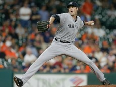 HOUSTON, TX - JULY 26:  Andrew Miller #48 of the New York Yankees pitches in the ninth inning aHouston Astros at Minute Maid Park on July 26, 2016 in Houston, Texas.  (Photo by Bob Levey/Getty Images)