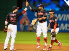 CLEVELAND, OH -  JULY 30: Jason Kipnis #22 Rajai Davis #20 and Francisco Lindor #12 of the Cleveland Indians celebrate after defeating the Oakland Athletics at Progressive Field on July 30, 2016 in Cleveland, Ohio. The Indians defeated the Athletics 6-3. (Photo by Jason Miller/Getty Images)  *** Local Caption *** Jason Kipnis; Rajai Davis; Francisco Lindor