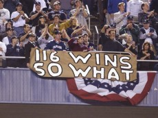 BRONX, NY - OCTOBER 22:  Fans of the New York Yankees stand and applaud in front of a sign referencing the Seattle Mariners regular season 116 victories during game five of the American League Championship Series on October 22, 2001 at Yankee Stadium in the Bronx, New York.  The Yankees defeated the Mariners 12-5 and won the best-of-seven series four games to one to advance to the World Series.  (Photo by Ezra Shaw/Getty Images)