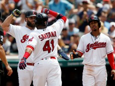 CLEVELAND, OH - AUGUST 04: Carlos Santana #41 of the Cleveland Indians celebrates with teammates Mike Napoli #26 and Francisco Lindor #12 after hitting a three run home run aganst the Minnesota Twins at Progressive Field in the third inning on August 4, 2016 in Cleveland, Ohio. (Photo by David Maxwell/Getty Images)