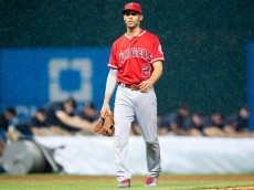 CLEVELAND, OH - AUGUST 11: Shortstop Andrelton Simmons #2 of the Los Angeles Angels of Anaheim walks off the field during the fourth inning against the Cleveland Indians as the game goes into a rain delay at Progressive Field on August 11, 2016 in Cleveland, Ohio. (Photo by Jason Miller/Getty Images)