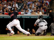 CLEVELAND, OH - AUGUST 18:  Jose Ramirez #11 of the Cleveland Indians hits an RBI single scoring Carlos Santana #41 (not pictured) against the Chicago White Sox in the fourth inning at Progressive Field on August 18, 2016 in Cleveland, Ohio. (Photo by David Maxwell/Getty Images)