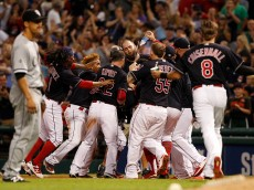 CLEVELAND, OH - AUGUST 18:  Teammates mob Tyler Naquin #30 of the Cleveland Indians after he hit a game winning sacrifice fly against the Chicago White Sox in the ninth inning at Progressive Field on August 18, 2016 in Cleveland, Ohio. The Indians defeated the White Sox 5-4.  (Photo by David Maxwell/Getty Images)