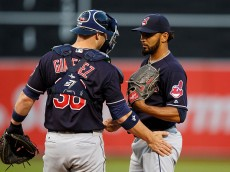 OAKLAND, CA - AUGUST 23:  Chris Gimenez #38 of the Cleveland Indians talks to Danny Salazar #31 on the pitchers mound during the first inning against the Oakland Athletics at the Oakland Coliseum on August 23, 2016 in Oakland, California. (Photo by Jason O. Watson/Getty Images)