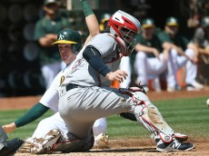 OAKLAND, CA - AUGUST 24:  Ryon Healy #48 of the Oakland Athletics slides in safe at home beating the throw to catcher Roberto Perez #55 of the Cleveland Indians in the bottom of the second inning at the Oakland Coliseum on August 24, 2016 in Oakland, California.  (Photo by Thearon W. Henderson/Getty Images)