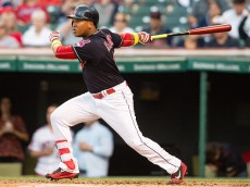 CLEVELAND, OH - SEPTEMBER 2: Jose Ramirez #11 of the Cleveland Indians hits an RBI single during the first inning against the Miami Marlins during an interleague game at Progressive Field on September 2, 2016 in Cleveland, Ohio. (Photo by Jason Miller/Getty Images)