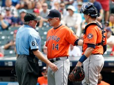CLEVELAND, OH - SEPTEMBER 08:  Manager A.J. Hinch #14 and catcher Jason Castro #15 of the Houston Astros argue with home plate umpire Jim Joyce #66 after Francisco Lindor #12 and Mike Napoli #26 of the Cleveland Indians scored on a wild pitch  in the third inning at Progressive Field on September 8, 2016 in Cleveland, Ohio. (Photo by David Maxwell/Getty Images)
